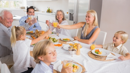 Happy family raising their glasses together for thanksgiving Stock Photo