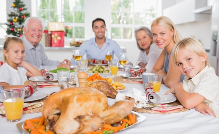 Focus on the roast turkey in front of family at chrismas dinner photo