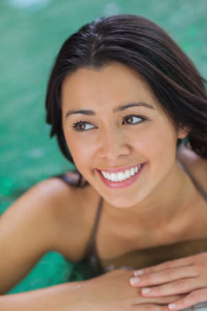 Attractive woman looking up from pool photo