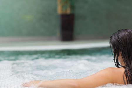 jacuzzi: Brunette woman relaxing in jacuzzi