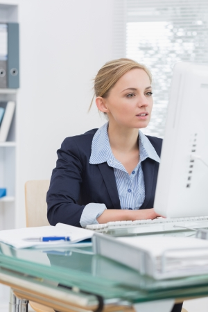 Young business woman working on computer at desk in office Stock Photo - 18108830