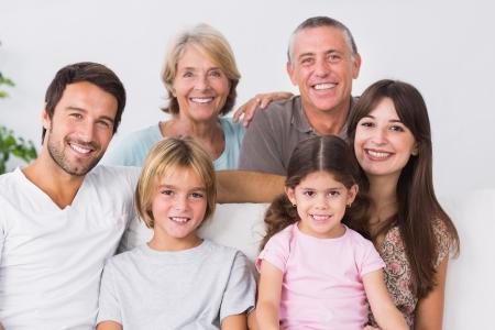 family sofa: Three generation family portrait Stock Photo