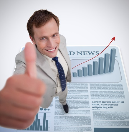 Smiling businessman giving thumb up against news print background photo
