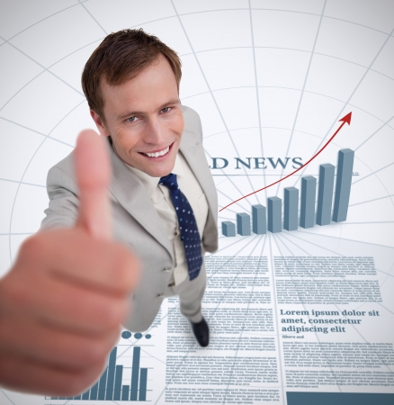 Close up of smiling businessman giving thumb up against a newspaper background photo