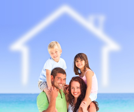 Smiling family posing with a blurred house illustration and the sea behind them illustration