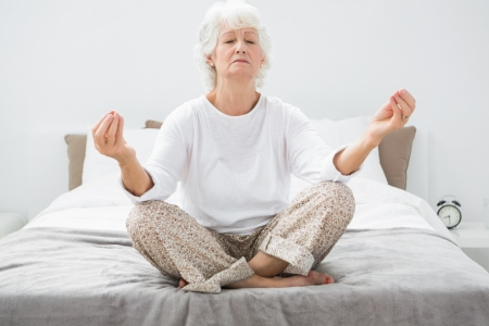 yoga pillows: Old woman relaxing on the bed