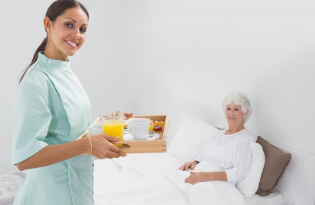 giver:  Elderly woman with home nurse in the bedroom