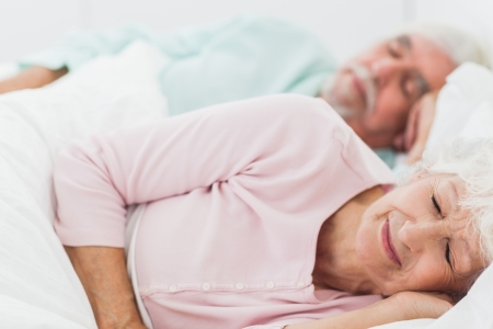 pillow sleep: Elderly couple sleeping in bed Stock Photo