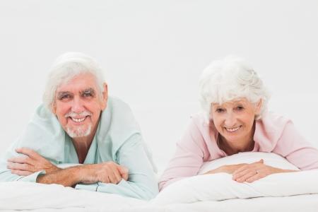 Happy elderly couple in bed Stock Photo - 18118291