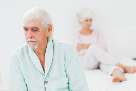 Elderly couple not talking to each other in bedroom Stock Photo - 18118272