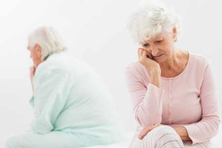 Elderly couple not talking to each other in bedroom Stock Photo - 18118292