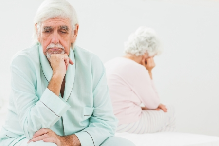 Sad elderly husband not talking to wife in bedroom Stock Photo - 18118293
