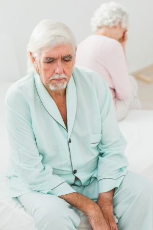 Elderly couple not speaking to each other in bedroom Stock Photo - 18118317