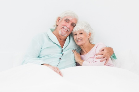 Smiling old couple in bed Stock Photo - 18118263