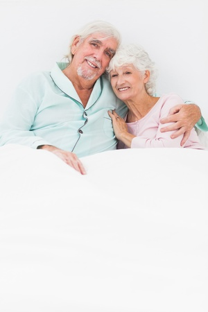 Happy old couple sitting in bed Stock Photo - 18118261