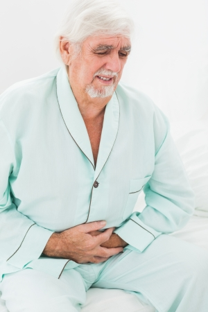 Elderly man with pain in stomach photo
