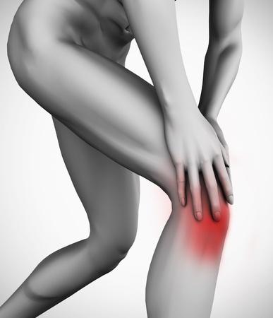 Knee pain on grey background photo