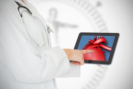 doctor tablet: Doctor showing her tablet with red heart on white background Stock Photo