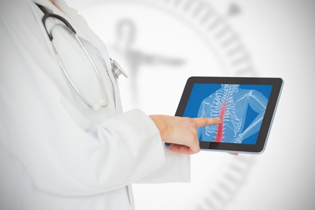 Doctor showing her tablet with red spin photo