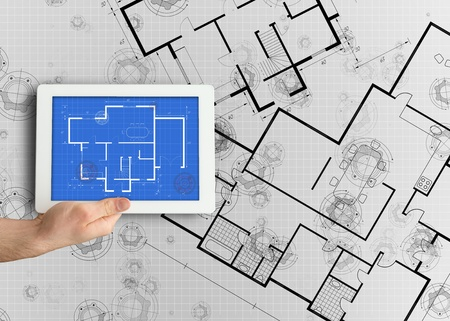 displaying: Digital tablet displaying blueprint on white background Stock Photo