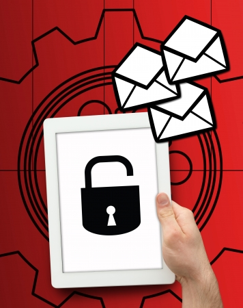 Tablet displaying lock symbol on red mechanics background Stock Photo - 18118686