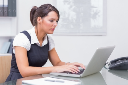 Woman working on her computer in the office Stock Photo - 18121558