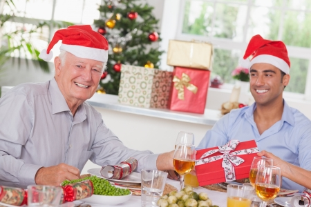 swapping: Family swapping christmas presents at christmas dinner