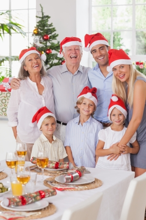 christmas cracker: Smiling family posing for photograph at christmas Stock Photo