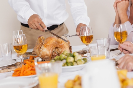 roast turkey: Turkey being carved at celebratory holiday dinner