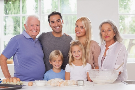 Smiling extended family baking portrait photo