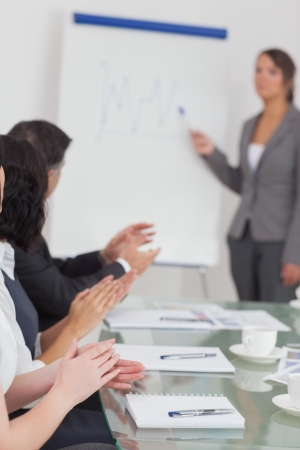 Businesswoman explaining and her colleagues clapping at a presentation Stock Photo - 18119256