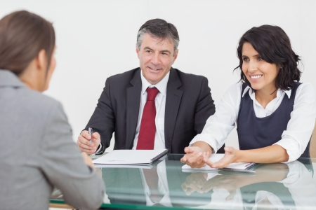 Business people talking in a small meeting in office photo