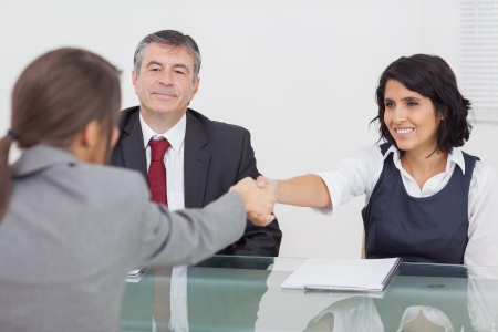 Two businesswomen shaking hands as an agreement photo
