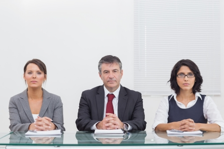 Three business people folding their hands and sitting Stock Photo - 18119260