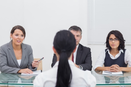 Three business people folding hands in small meeting attentively Stock Photo - 18119265