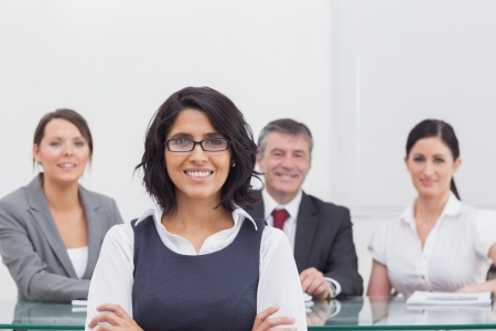Four business people at a desk Stock Photo - 18119264