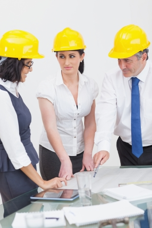Architects looking at construction plan in office Stock Photo - 18119771