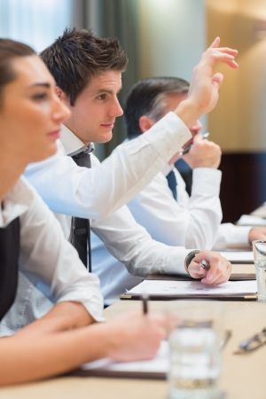 Businessman asking question during meeting photo