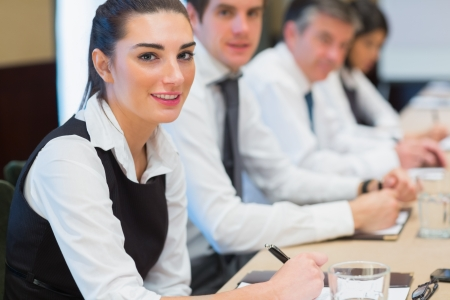 Smiling business woman in a meeting Stock Photo - 18120058