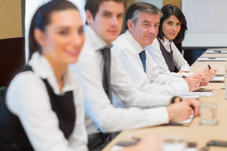 Smiling business people in a row in a meeting Stock Photo - 18120048