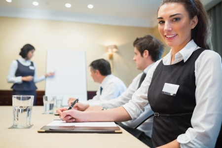 Smiling businesswoman during a presentation in conference room Stock Photo - 18120111
