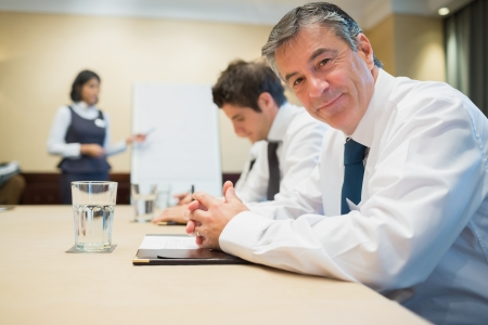 Smiling businessman during meeting in conference room Stock Photo - 18120104