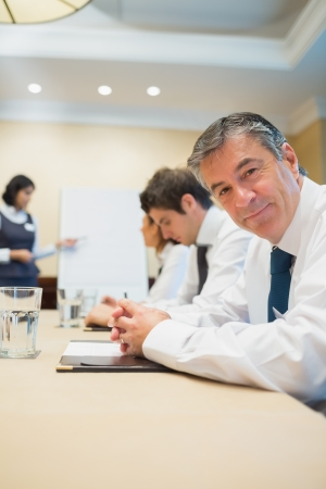 Happy businessman at presentation in conference room Stock Photo - 18120120