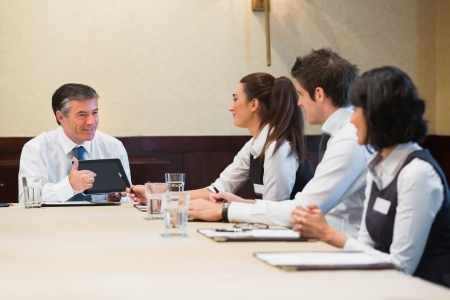 Businessman using tablet during meeting photo