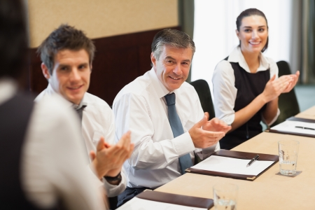 hotel staff: Business people clapping after a presentation in conference room Stock Photo