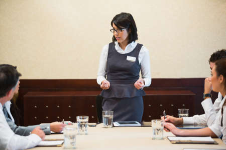 Business woman giving a talk in conference room Stock Photo - 18120587