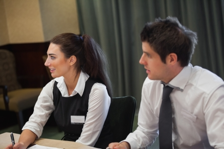 Smiling business people at meeting in conference room photo