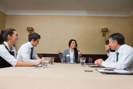 Businesswoman talking at meeting in conference room photo