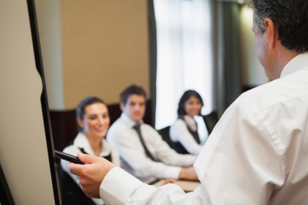Man giving a business presentation in conference room