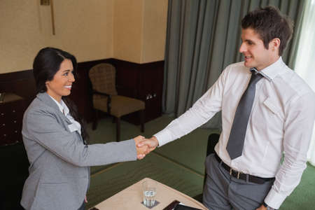 Business people shaking hands at meeting in conference room photo
